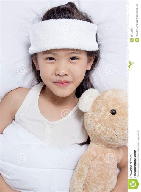 has fever asian child has fever and laying on the bed get well stock photo image 51392670