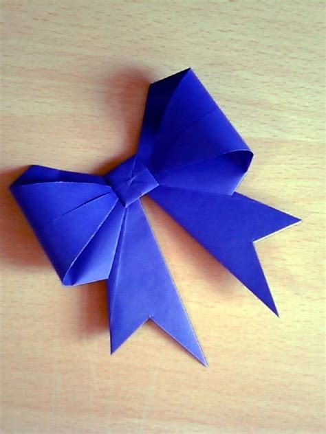 Origami Bows - diy origami gift bow awesomeness origami