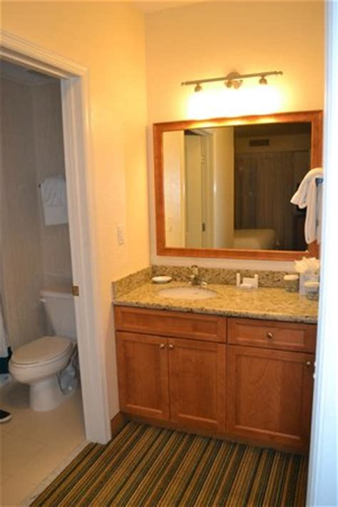 sink and vanity outside the bathroom in second bedroom