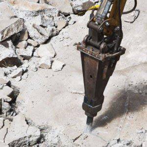 Demilatory Removal experienced concrete contractors in calgary concrete patios paving stones rocky landscapes