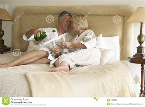 pictures couple in bedroom middle aged couple enjoying chagne in bedroom stock