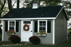 Lp Topi Brown glacier blue siding cobblestone rock russet door black shutters siding