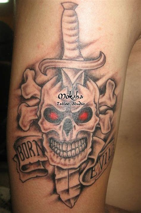red eyes skull and dagger tattoo on bicep tattoos