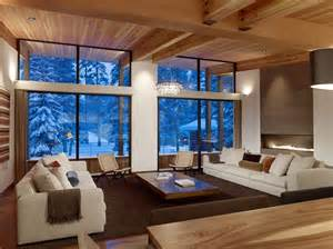 Modern Home Living Room by Modern Mountain Home Uses Railroad Avalanche Shed Design