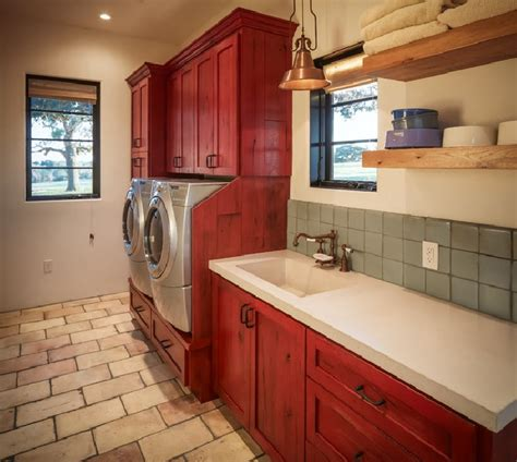 rustic laundry room decor brick flooring and painted cabinet for rustic laundry