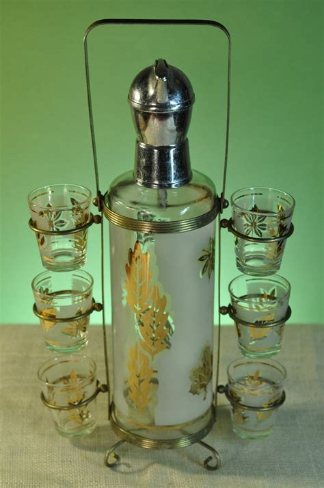 vintage barware gold leaf decanter and shot glass set with carrier vintage