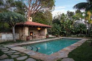 mediterranean swimming pool with flagstone deck for