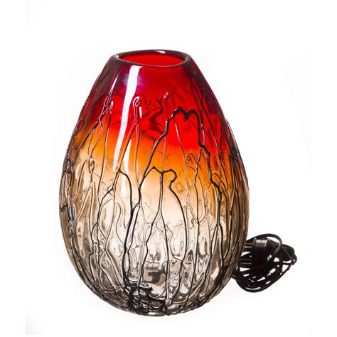 striking hand blown glass lamp in red and black