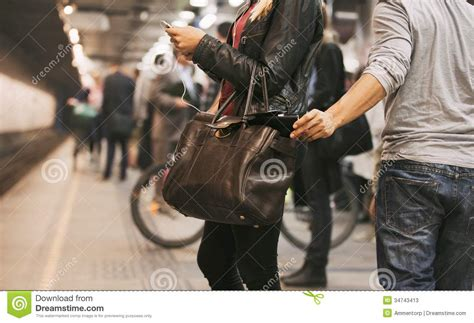 males being bobbed thief stealing wallet at the subway station stock image