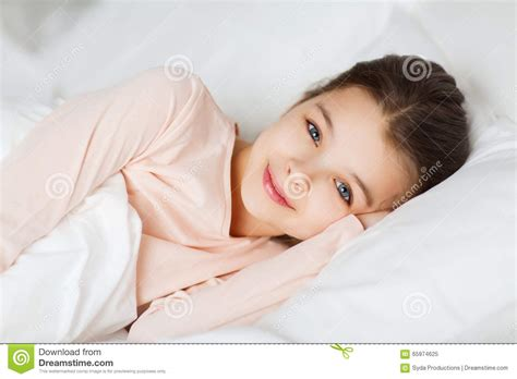people in bed happy smiling girl lying awake in bed at home stock image