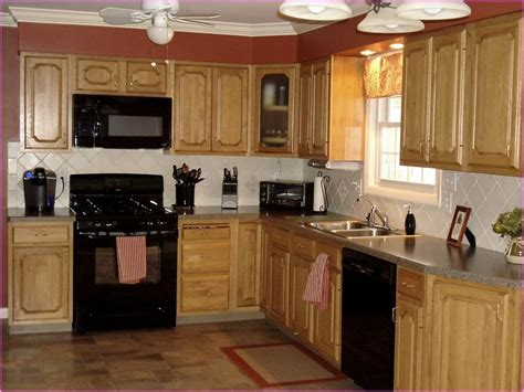 oak and black kitchen cabinets kitchen color ideas with oak cabinets and black appliances