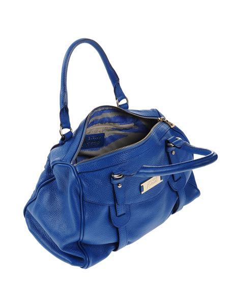Guess Blue guess handbag in blue lyst