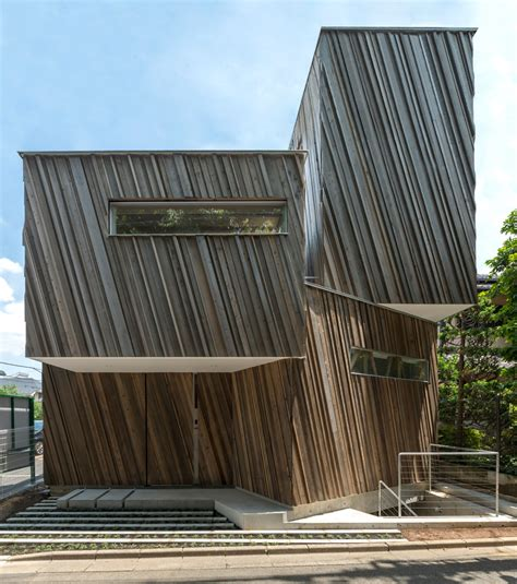 swing architecture kyodo house by sandwich features a sculptural wood facade