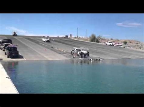 driving boat into slip truck rolls in to water lake pleasant boat launch youtube