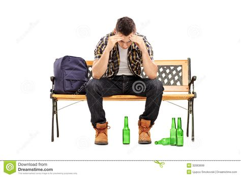 man sitting on bench young man with hangover sitting on a bench royalty free stock images image 32063699
