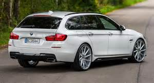 white bmw 5 series touring puts on 22 quot wheels
