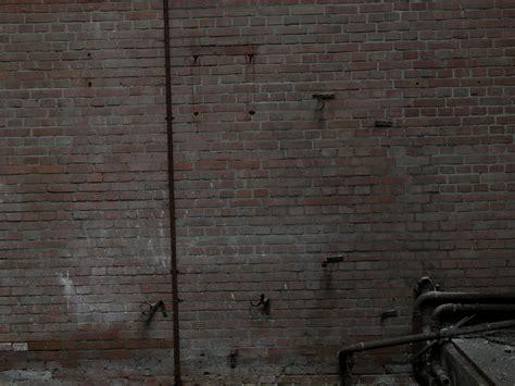 dark wall alleyway wall background www imgkid com the image kid