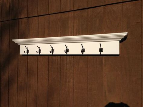 large white entry way coat rack with 6 hooks 5 foot wall