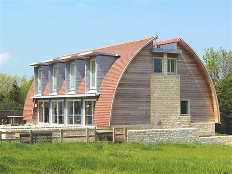 who designs homes curved roof house plan makes a stylish eco statement