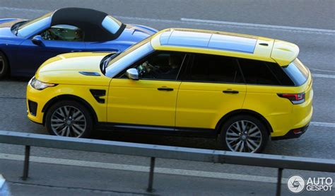 land rover yellow range rover sport svr spotted in yellow