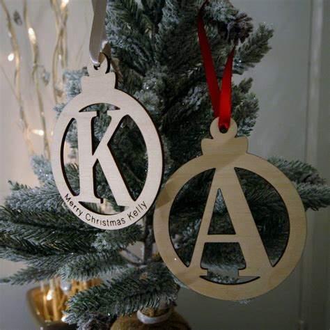 wooden christmas letter baubles by wendover wood