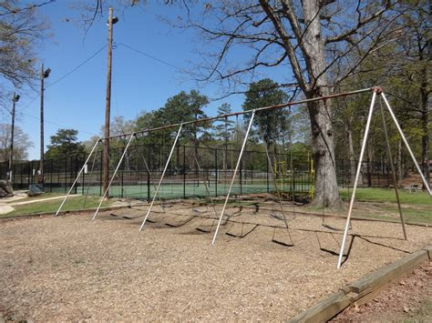 large swing file large swing set city park griffin jpg wikimedia