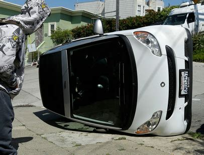 tipped smart cars smart cars being tipped in san fran