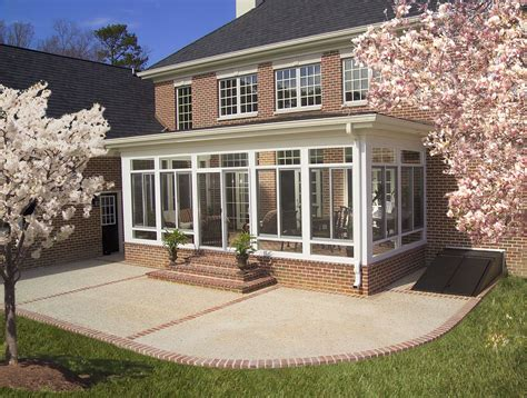 enclosed porch,outside view   Many people use sunrooms to