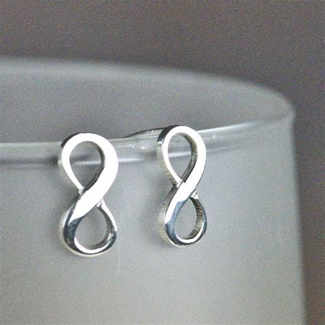 sterling silver infinity stud earrings by tales from the