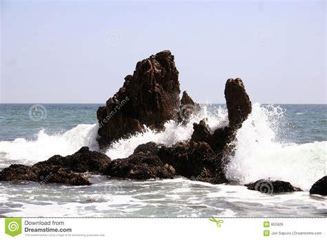 Crashing On The by Waves Crashing Into Rocks Stock Photo Image Of Crash