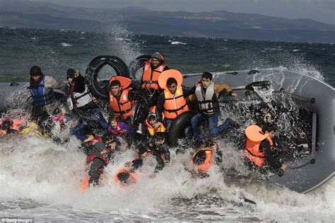 refugee boats to italy migrants leave 25ft mountain of lifejackets in lesbos