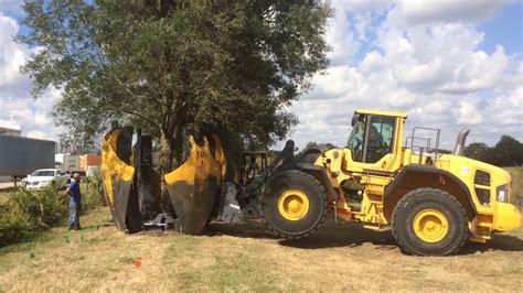 Tree Spandek 106 inch loader mounted curved tree spade working