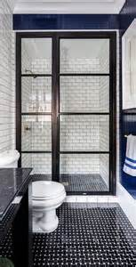 black shower door bathroom with black basket wave tile floor contemporary