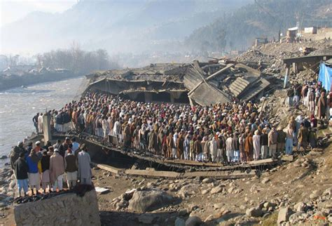 Pakistan Earthquake 2005 Essay by Earthquakes Of The New Century Survivors Of The 2005 Kashmir Earthquake Offer Prayers In
