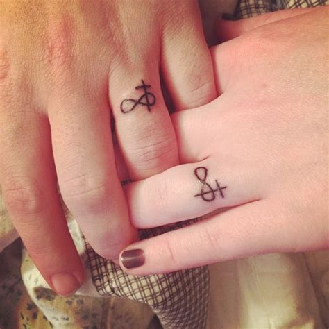 cross ring tattoos 35 sweet simple wedding band tattoos