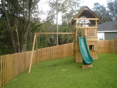 swing ground set on a slope tallahassee swing sets by design custom