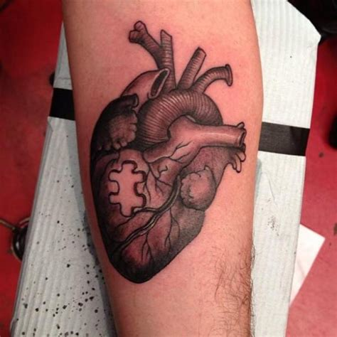 heart puzzle tattoo arm puzzle by camila rocha