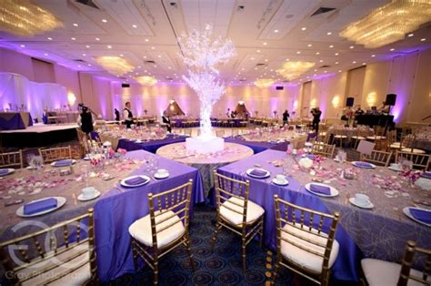 wedding and reception in same room ceremony reception in the same room photo of the reception with purple details aniqua
