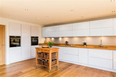 Decorating Ideas For Kitchen Cabinet Tops by Nobilia White High Gloss Kitchen With Solid Wood Worktop