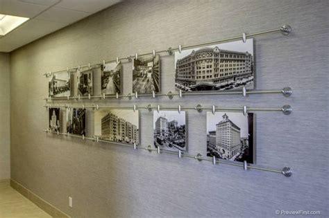 design photo wall display custom art display shows 100 years of companies history