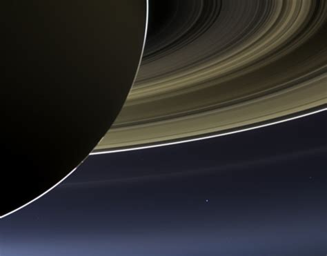 earth as seen from saturn the day the earth smiled saturn shines in this amazing
