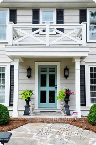 bright turquoise storm door  light gray exterior