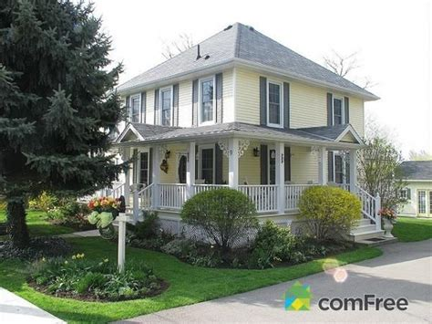 houses with shutters yellow house with gray shutters house ideas pinterest