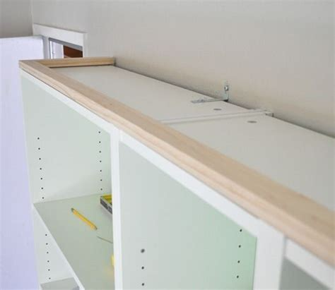making ikea cabinets look built in how to make ikea billy bookcases look like built ins been