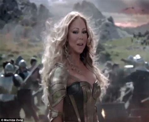 commercial girl game of war mariah carey s game of war commercial sees her shoot and