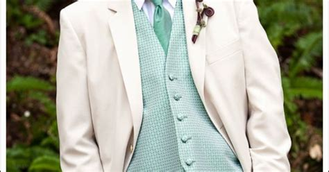 light colored tuxedos mint green vest tie and flower boutonniere on light