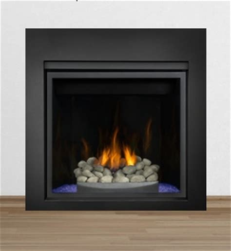 gas fireplace with glass rocks hd fireplace with river rock on blue glass with black 4 side surround hd series gas
