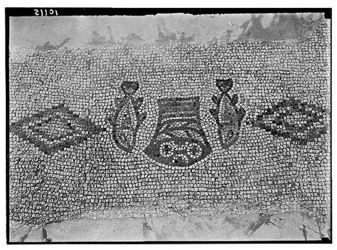 mosaic of fish and loaves found at capernaum sea of