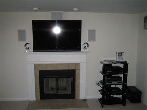 home theater subwoofer tv  fireplace wires hidden