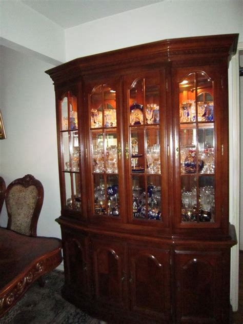 cherry wood china cabinet with display lighting also